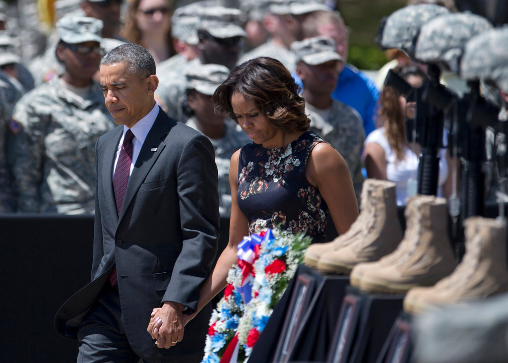 . President Barack Obama and first lady Michelle Obama arrive for a memorial ceremony, Wednesday, April 9, 2014, at Fort Hood Texas, for those killed there in a shooting last week. President Barack Obama is reprising his role as chief comforter as he returns once again to a grief-stricken corner of America to mourn with the families of those killed last week at Fort Hood and offer solace to the nation.(AP Photo/Carolyn Kaster)