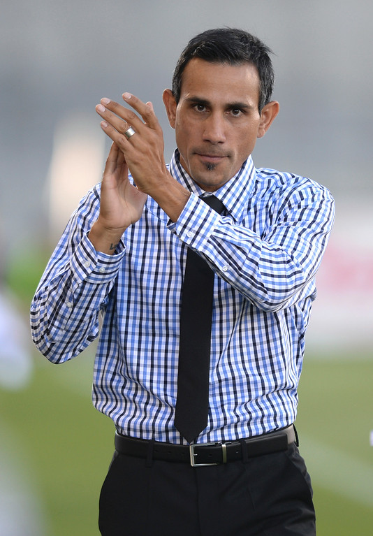. COMMERCE CITY, CO - JUNE 28: Colorado coach Pablo Mastroeni saluted the fans before the game. The Colorado Rapids defeated the Vancouver Whitecaps 2-0 at Dick\'s Sporting Goods Park Saturday night, June 28, 2014.  Photo by Karl Gehring/The Denver Post