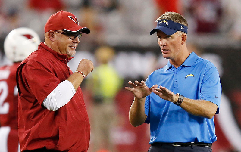 . San Diego Chargers head coach Mike McCoy, right, talks with Arizona Cardinals head coach Bruce Arians prior to an NFL football game Monday, Sept. 8, 2014, in Glendale, Ariz. (AP Photo/Ross D. Franklin)