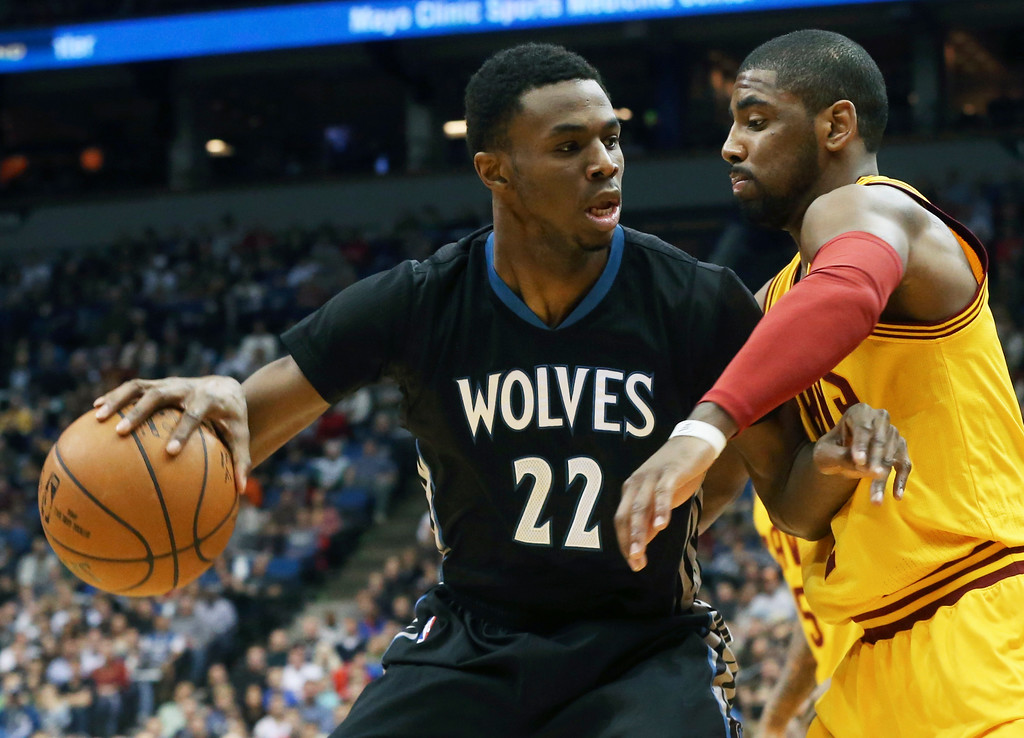 . Minnesota Timberwolves� Andrew Wiggins, left, keeps the ball at arm\'s length from Cleveland Cavaliers�s Kyrie Irving in the first quarter of an NBA basketball game, Saturday, Jan. 31, 2015, in Minneapolis. (AP Photo/Jim Mone)
