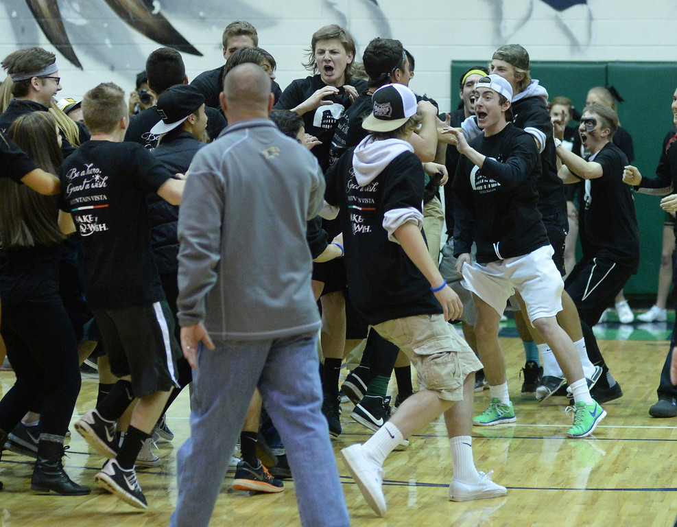 . HIGHLANDS RANCH, CO. - FEBRUARY 7, 2014: Mountain Vista fans mobbed the team on the court following the win. The Mountain Vista High School boy\'s basketball team defeated ThunderRidge 60-50 Friday night, February 7, 2014. Photo By Karl Gehring/The Denver Post