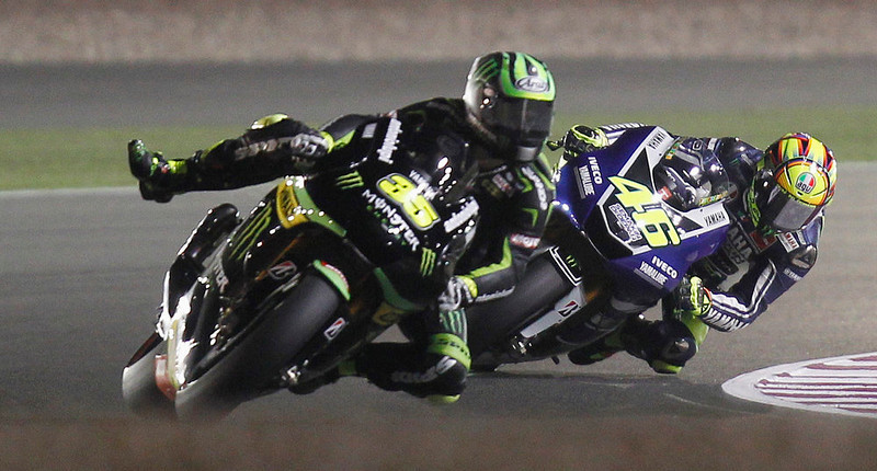 . Yamaha MotoGP rider Valentino Rossi (R) of Italy and Yamaha MotoGP rider Cal Crutchlow of Britain participate in a free practice for the Qatar Grand Prix at Losail International Circuit in Doha April 4, 2013. REUTERS/Mohammed Dabbous