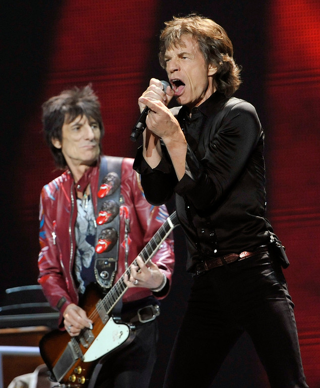 ". Mick Jagger, right, and Ron Wood of the Rolling Stones perform on the kick-off of the band\'s ""50 and Counting\"" tour at the Staples Center on Friday, May 3, 2013 in Los Angeles. (Photo by Chris Pizzello/Invision/AP)"