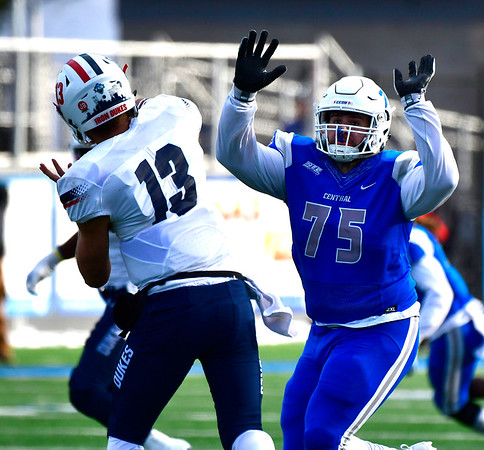 11/17/2018 Mike Orazzi | Staff CCSU's Chris Tinkham (75) and Duquesne's Daniel Parr (13) at Arute Field in New Britain Saturday afternoon.