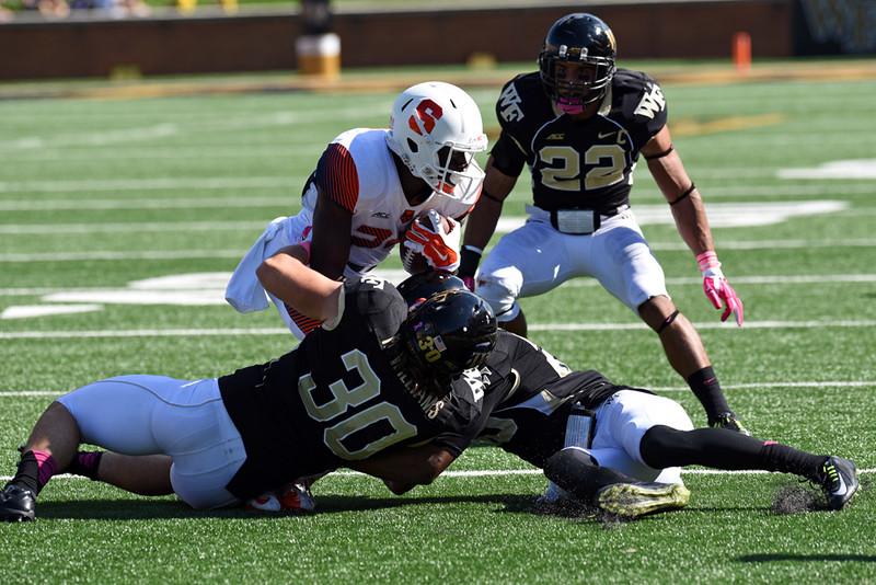 H Williams B Watson R Janvion tackle J Kobena.jpg