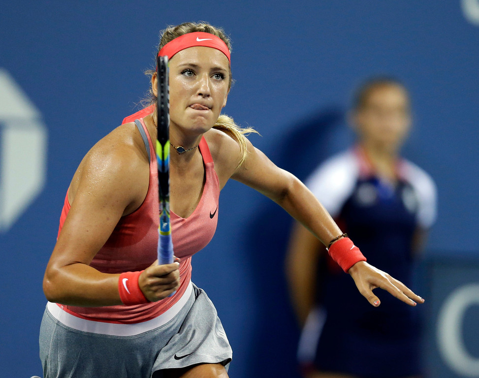 . Belarus\'s Victoria Azarenka chases down a shot by�Germany\'s Dinah Pfizenmaier during the first round of the U.S. Open tennis tournament Tuesday, Aug. 27, 2013, in New York. (AP Photo/Darron Cummings)