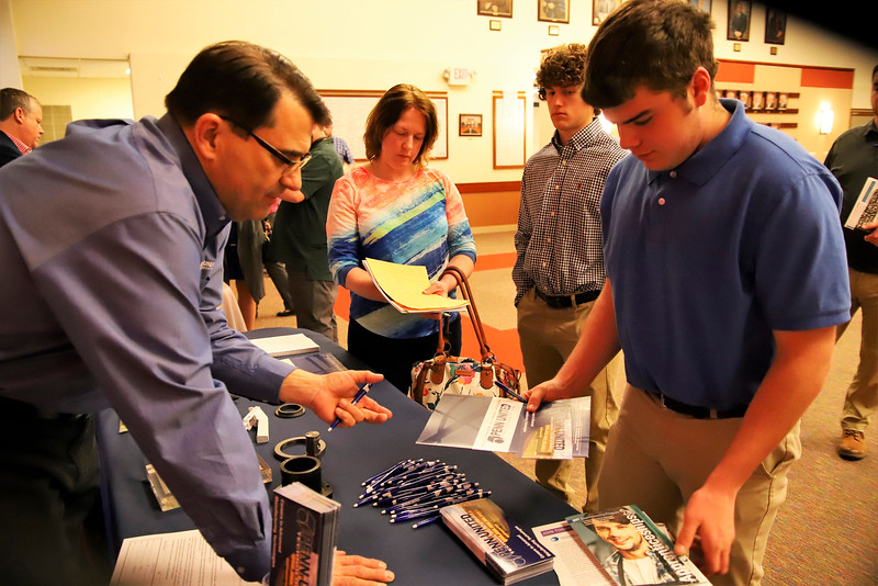 Penn United Technologies Inc. HR manager Jim McKain shares pre-apprenticeship information with Lenape Tech junior Glenn Spath, 16, of Freeport Wednesday night at the Apprenticeship Summit at Butler County Community College 04/17/19.