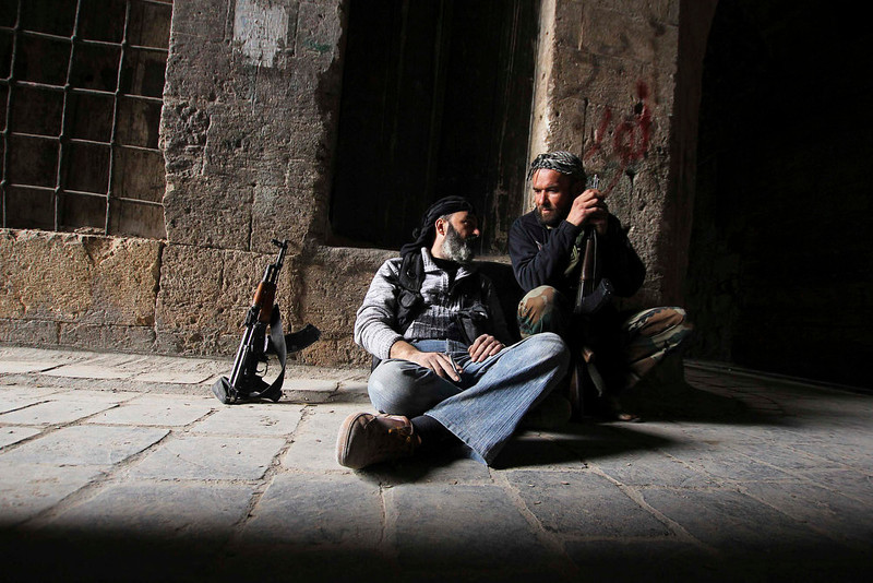 . Fighters from the Aoun-bi-allah Brigade, which operates under the Free Syrian Army, rest in Aleppo March 16, 2013. REUTERS/Giath Taha