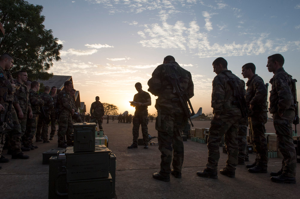 """. In this picture dated Sunday, Jan. 13, 2013 and released by the French Army Communications Audiovisual office (ECPAD) s French soldiers of the 2nd Marine Infantry Regiment based in Le Mans, western France, listen to their officer during a briefing at Bamako airport, Mali. An official at France\'s Defense Ministry says the country will \""""gradually deploy\"""" a total of 2,500 troops to Mali, and the French president says the military operation will last until security has been restored and African forces are ready to take charge. (AP Photo/Arnaud Roine, ECPAD)"""