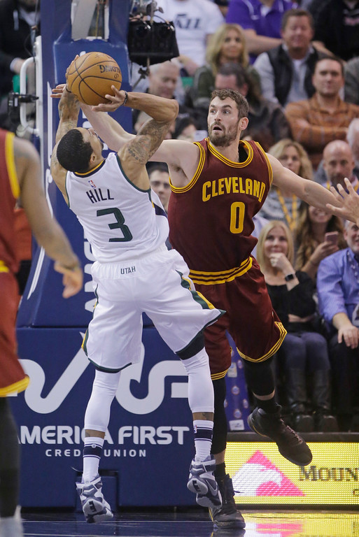 . Utah Jazz guard George Hill (3) shoots as Cleveland Cavaliers forward Kevin Love (0) defends in the first half during an NBA basketball game Tuesday, Jan. 10, 2017, in Salt Lake City. (AP Photo/Rick Bowmer)