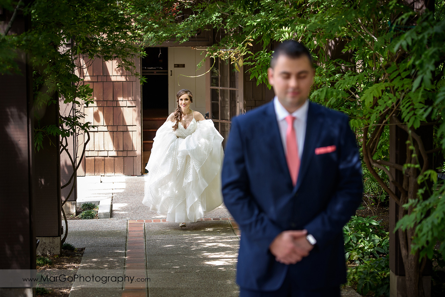 bride approaching groom during first look at Saratoga Foothill Club