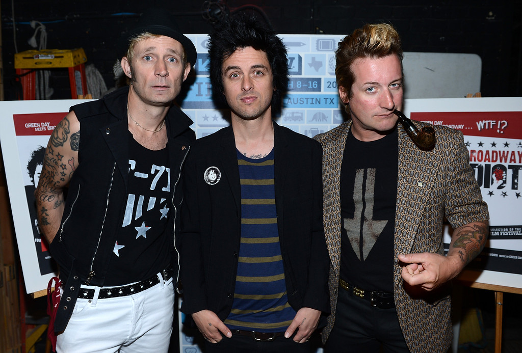 ". (L-R) Mike Dirnt, Billie Joe Armstrong and Tre Cool of Green Day pose backstage for a picture before the World Premiere of ""Broadway Idiot\"" during the 2013 SXSW Music, Film + Interactive Festival at the Paramount Theatre on March 15, 2013 in Austin, Texas."