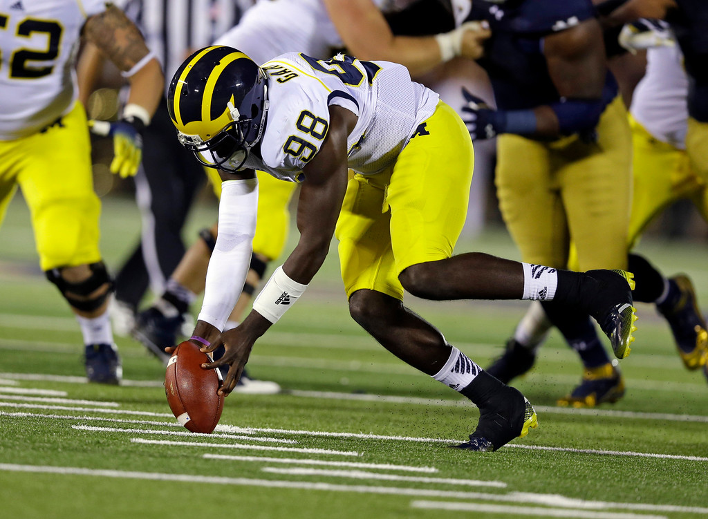 . Michigan quarterback Devin Gardner recovers his fumble during the first half of an NCAA college football game against Notre Dame in South Bend, Ind., Saturday, Sept. 6, 2014. (AP Photo/Michael Conroy)