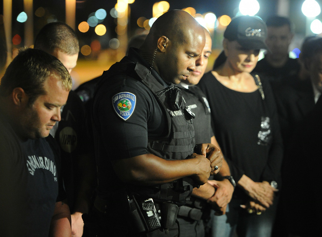 . A vigil was held for wounded San Bernardino Police officer Gabriel Garcia in front of Arrowhead Regional Medical Center in Colton, Ca., Friday, August 22, 2014. Garcia is being treated at the hospital after suffered two gunshot wound to the upper torso during an early morning shoot out in San Bernardino. (Photo by John Valenzuela/ The Sun)