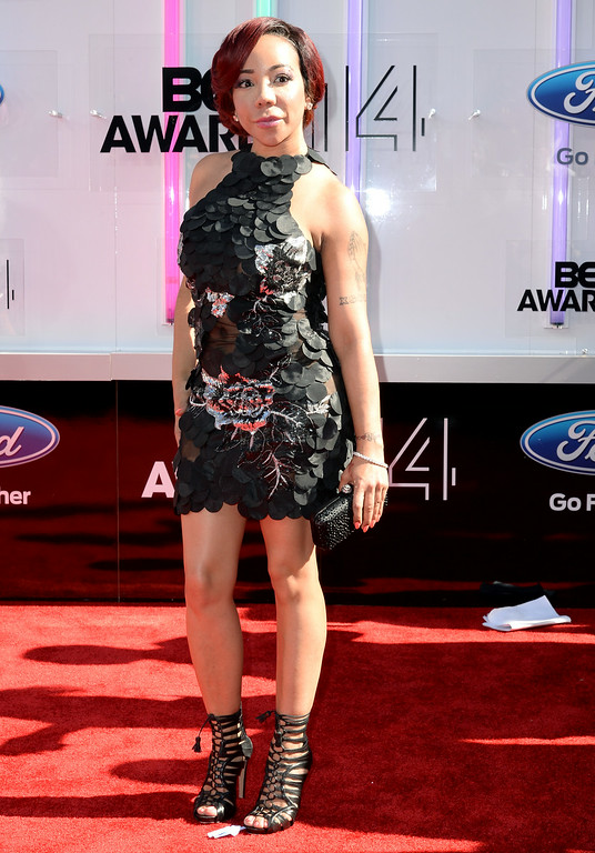 ". Singer Tameka ""Tiny\"" Harris attends the BET AWARDS \'14 at Nokia Theatre L.A. LIVE on June 29, 2014 in Los Angeles, California.  (Photo by Earl Gibson III/Getty Images for BET)"