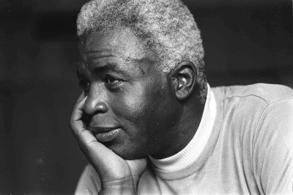 . FILE - In this June 30, 1971 file photo,  Jackie Robinson poses at his home in Stamford, Conn.   (AP Photo/File)