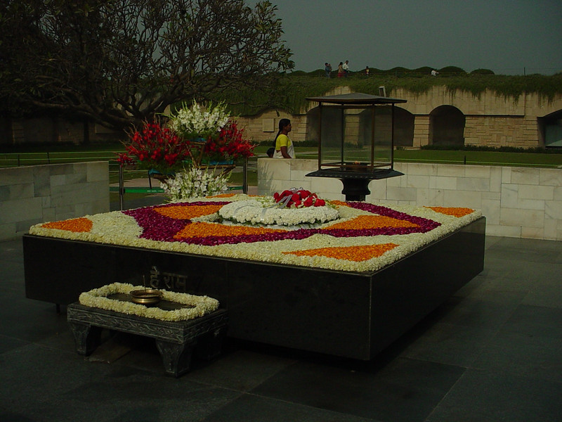 Ghandi's burial with fresh flowers and eternal flame