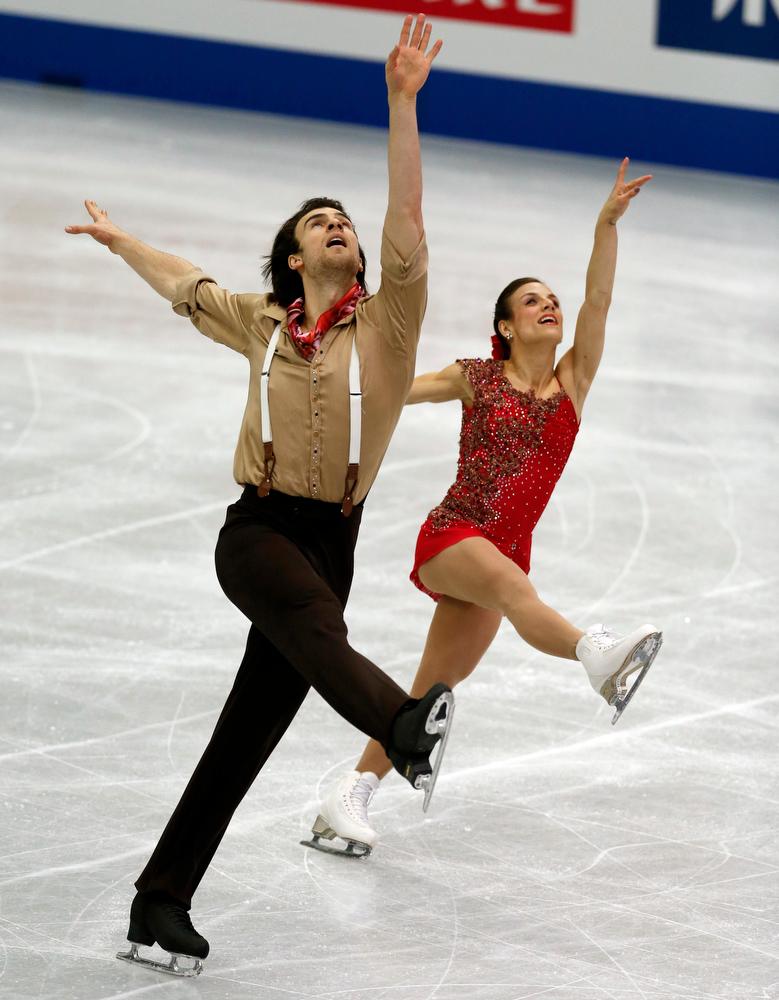 Description of . Meagan Duhamel, right, and Eric Radford of Canada perform during the pairs short program at the ISU Four Continents Figure Skating Championships in Osaka, western Japan, Friday, Feb. 8, 2013. (AP Photo/Shizuo Kambayashi)