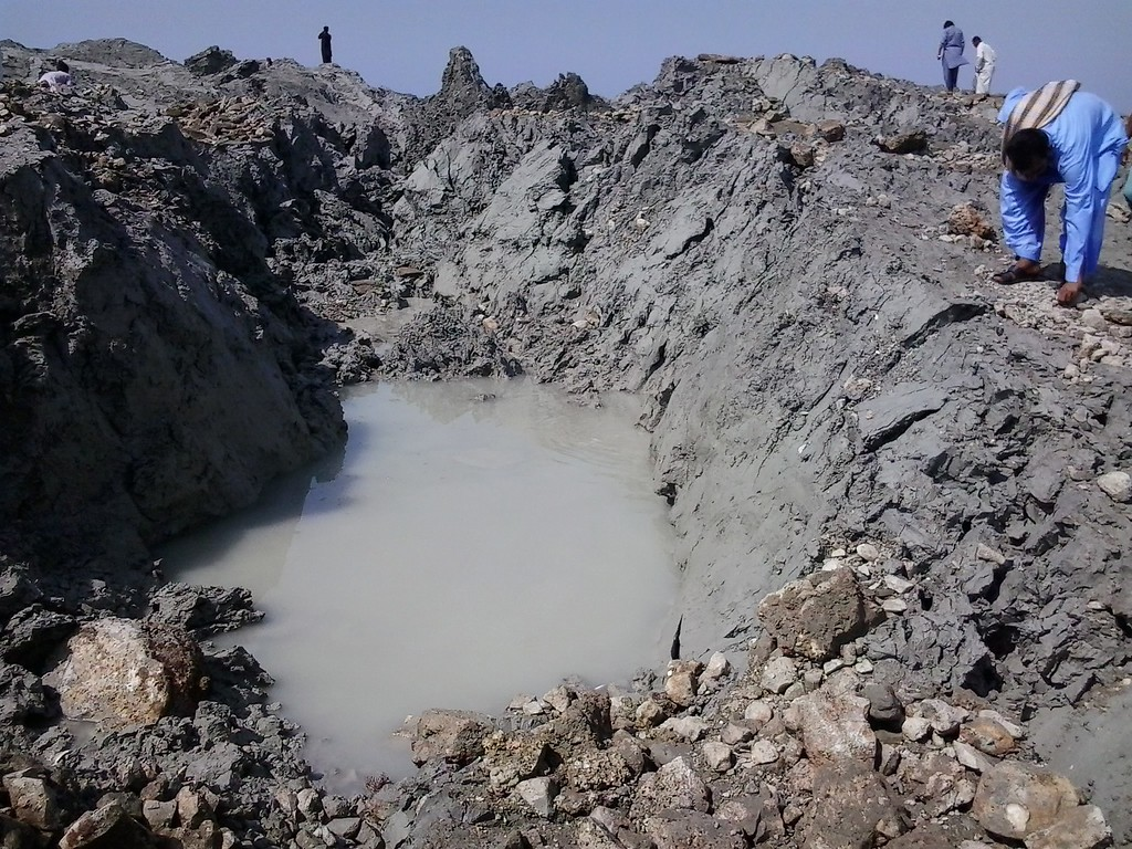 . This photograph taken on September 25, 2013, shows Pakistani residents as they gather on an island that appeared some two kilometres off the coastline of Gwadar after an earthquake. A small island of mud and rock created by the huge earthquake that hit southwest Pakistan has fascinated locals but experts -- who found methane gas rising from it -- say it is unlikely to last long. The 7.7-magnitude quake struck on September 24, in Baluchistan\'s remote Awaran district, killing at least 271 people and affecting hundreds of thousands. AFP PHOTO / Behram  BALOCH/AFP/Getty Images