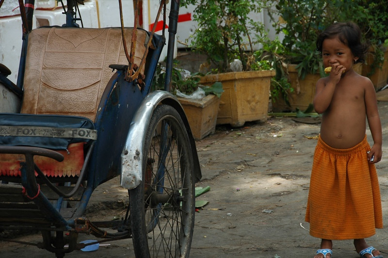 Girl with a Cyclo - Phnom Penh, Cambodia