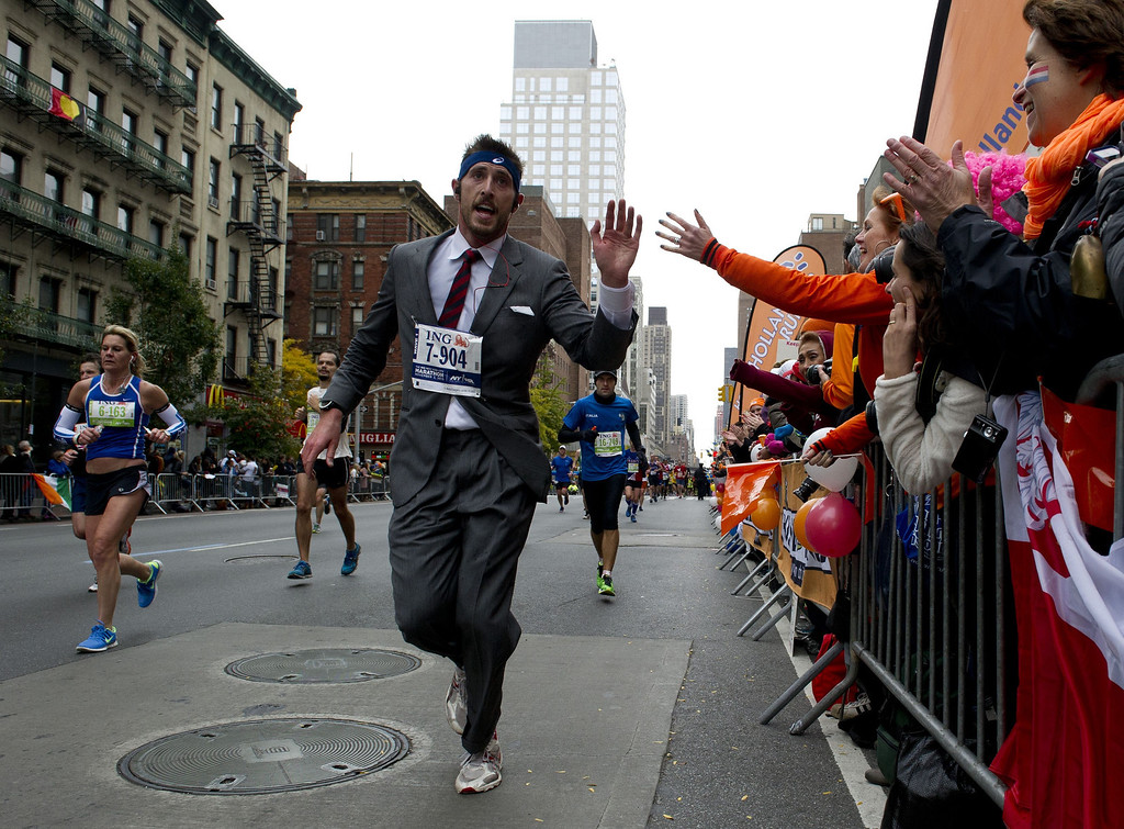 . A man in a suit runs up First Avenue November 3, 2013 during the running of the New York City Marathon in New York.    DON EMMERT/AFP/Getty Images