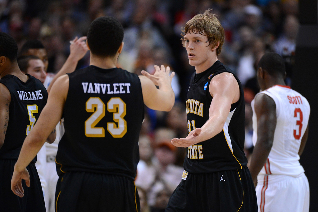 . LOS ANGELES, CA - MARCH 30:  Ron Baker #31 and Fred Van Vleet #23 of the Wichita State Shockers celebrate in the second half while taking on the Ohio State Buckeyes during the West Regional Final of the 2013 NCAA Men\'s Basketball Tournament at Staples Center on March 30, 2013 in Los Angeles, California.  (Photo by Harry How/Getty Images)