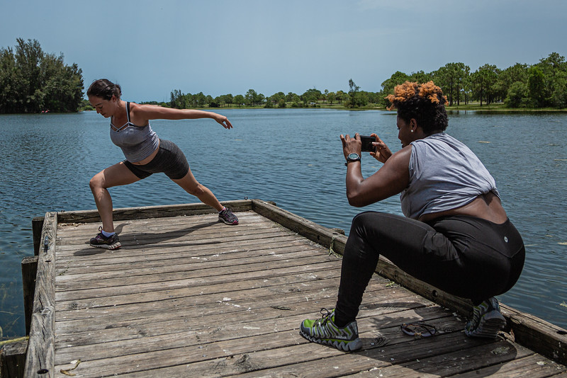 """Chiquita Carnegie, right, of Royal Palm Beach makes a photo of her friend Kara Schwarz of West Palm Beach, at Okeeheelee Park on Sunday, June 28, 2020. Carnegie and Schwarz took """"before"""" photos of each other at the start of a friendly weight loss competition. [JOSEPH FORZANO/palmbeachpost.com]"""