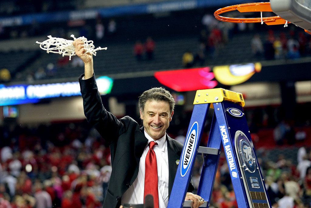 . Head coach Rick Pitino of the Louisville Cardinals celebrates with the net after they won 82-76 against the Michigan Wolverines during the 2013 NCAA Men\'s Final Four Championship at the Georgia Dome on April 8, 2013 in Atlanta, Georgia.  (Photo by Streeter Lecka/Getty Images)