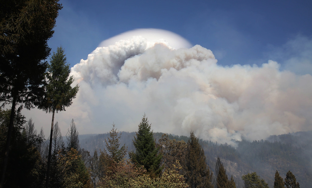 . Smoke from a wildfire rises into the sky near Pollack Pines, Calif., Monday, Sept. 15, 2014. The fire, which started Sunday has consumed more than 3,000 acres and forced the evacuation of dozens of homes. (AP Photo/Rich Pedroncelli)