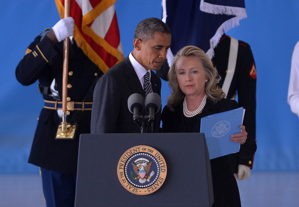 . US President Barack Obama and Secretary of State Hillary Clinton attend the transfer of remains ceremony marking the return to the US of the remains of the four Americans killed in an attack this week in Benghazi, Libya, at the Andrews Air Force Base in Maryland on September 14, 2012. US Ambassador Christopher Stevens died on Tuesday along with three other Americans in the assault on the consular building in Benghazi, on the 11th anniversary of the September 11 attacks. AFP PHOTO/Jewel Samad        (Photo credit should read JEWEL SAMAD/AFP/GettyImages)