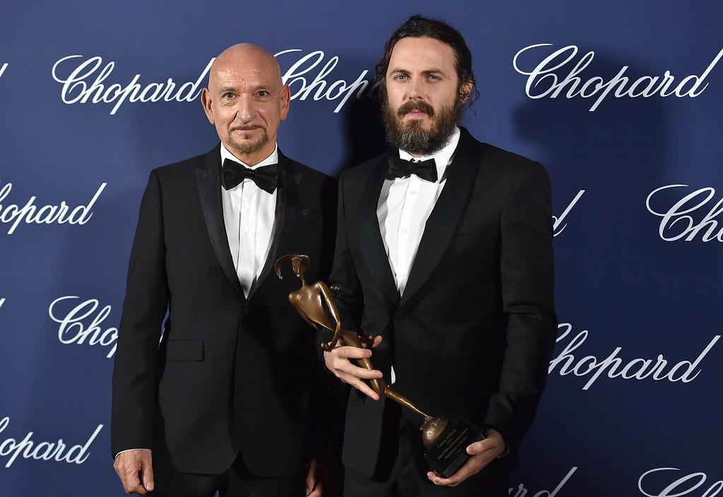 ". Casey Affleck, winner of the Desert Palm Achievement actor award for ""Manchester by the Sea,\"" poses backstage with presenter Ben Kingsley at the 28th annual Palm Springs International Film Festival Awards Gala on Monday, Jan. 2, 2017, in Palm Springs, Calif. (Photo by Jordan Strauss/Invision/AP)"