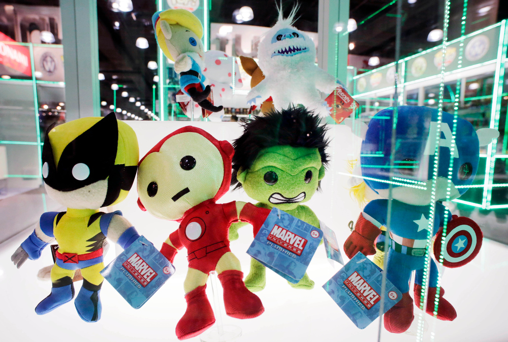Description of . Plush dolls, based on Marvel Comic\'s characters and manufactured by Funko, are displayed at the American International Toy Fair, Monday, Feb. 11, 2013 in New York. (AP Photo/Mark Lennihan)