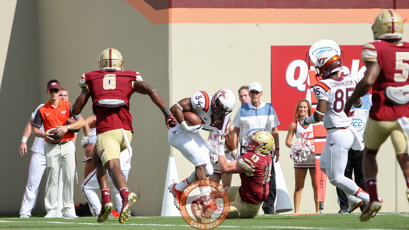 RB Travon McMillian drags Boston College LB Connor Strachan on his way to the endzone. (Mark Umansky/TheKeyPlay.com)