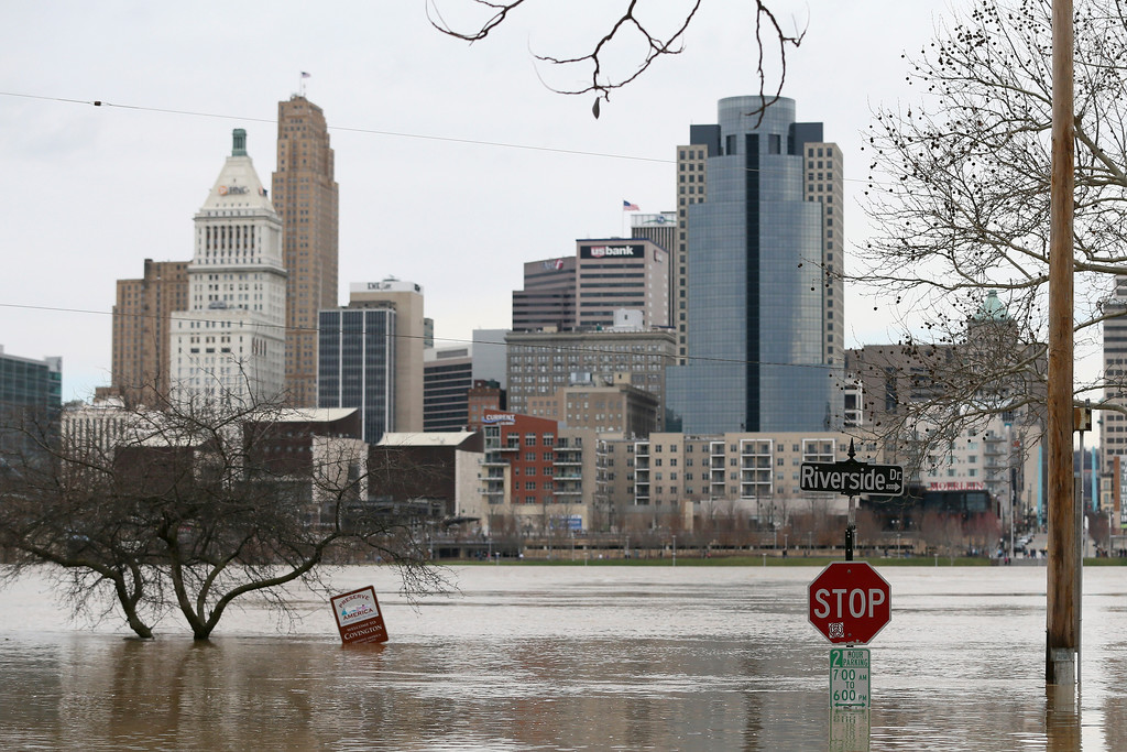 . View looking north to Cincinnati as flood waters rise toward the intersection of Riverside Drive and Garrard Street, Sunday, Feb. 25, 2018, in Covington, Ky. The Ohio River is expected to crest at 60.7 feet by Sunday evening, according to the National Weather Service. The river rose above the 60 feet mark for the first time in two decades Sunday morning.  (Kareem Elgazzar/The Cincinnati Enquirer via AP)