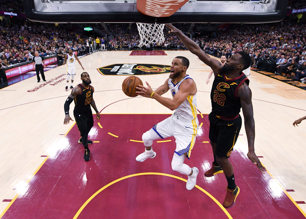 . Golden State Warriors guard Stephen Curry shoots in front of Cleveland Cavaliers forward Jeff Green, right, during Game 4 of basketball\'s NBA Finals on Friday, June 8, 2018, in Cleveland. The Warriors defeated the Cavaliers 108-85 to sweep the series. (Gregory Shamus/Pool Photo via AP)