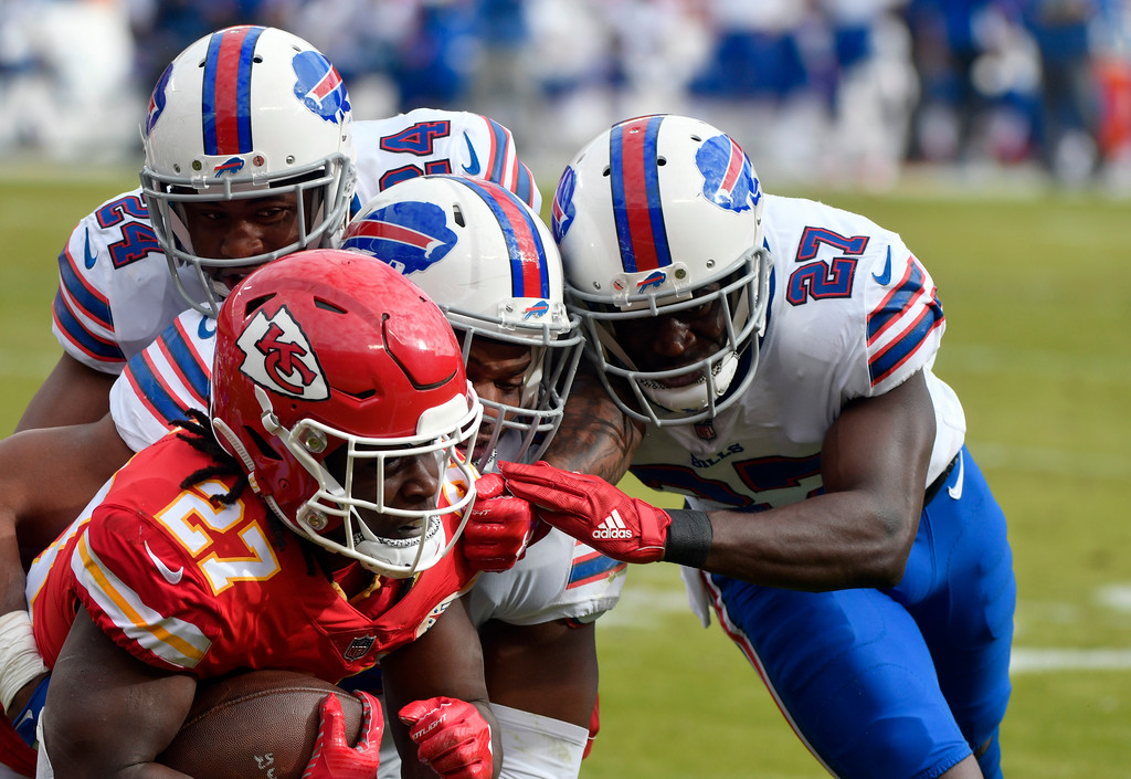 . Kansas City Chiefs running back Kareem Hunt (27) is tackled by Buffalo Bills linebacker Preston Brown (52), cornerback Tre\'Davious White (27) and cornerback Leonard Johnson (24) during the first half of an NFL football game in Kansas City, Mo., Sunday, Nov. 26, 2017. (AP Photo/Ed Zurga)