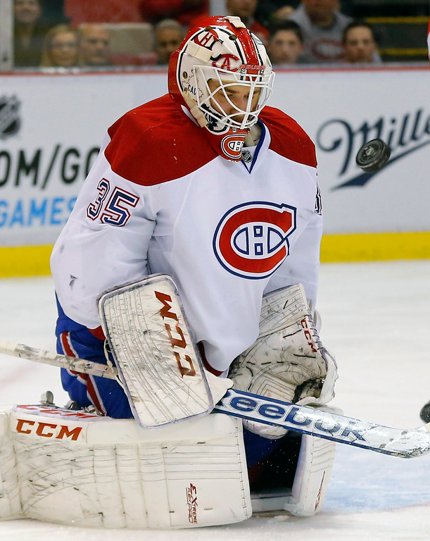 . Montreal Canadiens goalie Dustin Tokarski (35) stops a Detroit Red Wings shot in the first period of an NHL hockey game in Detroit, Sunday, Nov. 16, 2014. (AP Photo/Paul Sancya)