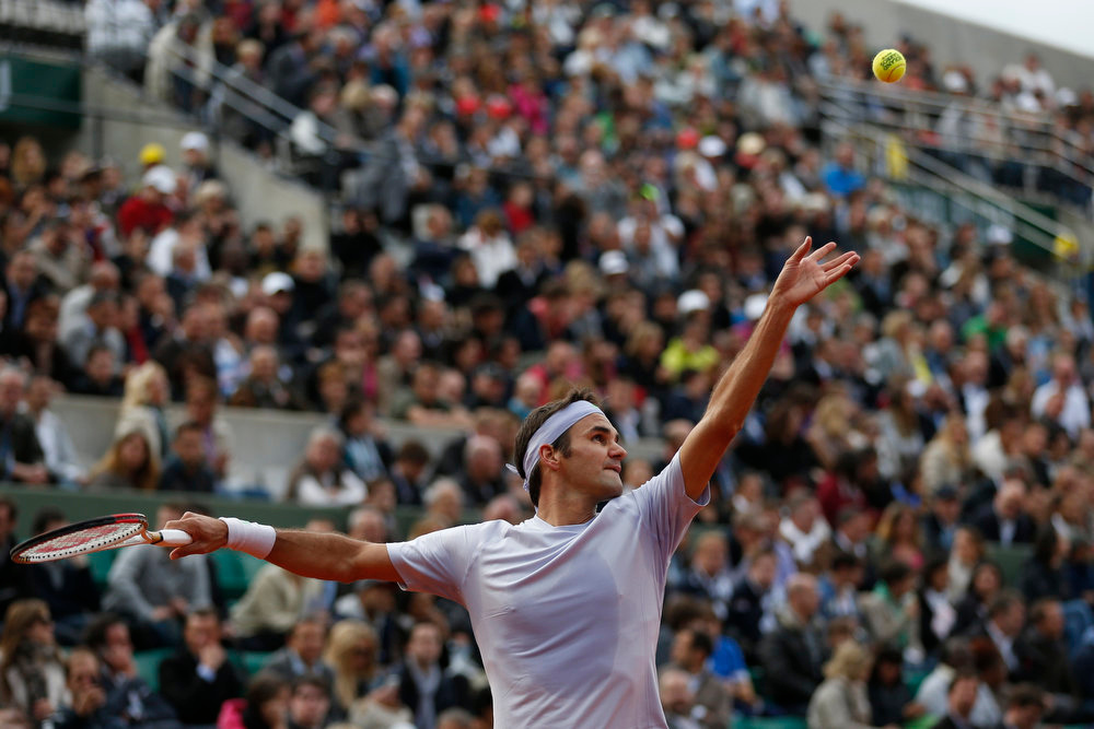 . Switzerland\'s Roger Federer serves against India\'s Somdev Devvarman in their second round match of the French Open tennis tournament, at Roland Garros stadium in Paris, Wednesday, May 29, 2013. Federer won in three sets 6-2, 6-1, 6-1. (AP Photo/Petr David Josek)