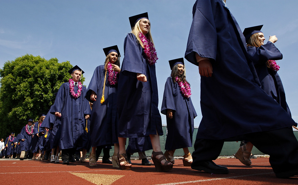 . The Notre Dame High School graduation class walk to the football field on Saturday, June 01, 2013 in Sherman Oaks, CA.  Photo by Michael Yanow