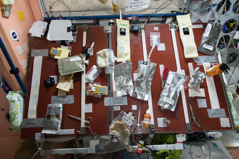 """""""Looks messy, but it's functional. Our #food table on the @space station. What's for breakfast? #YearInSpace"""""""