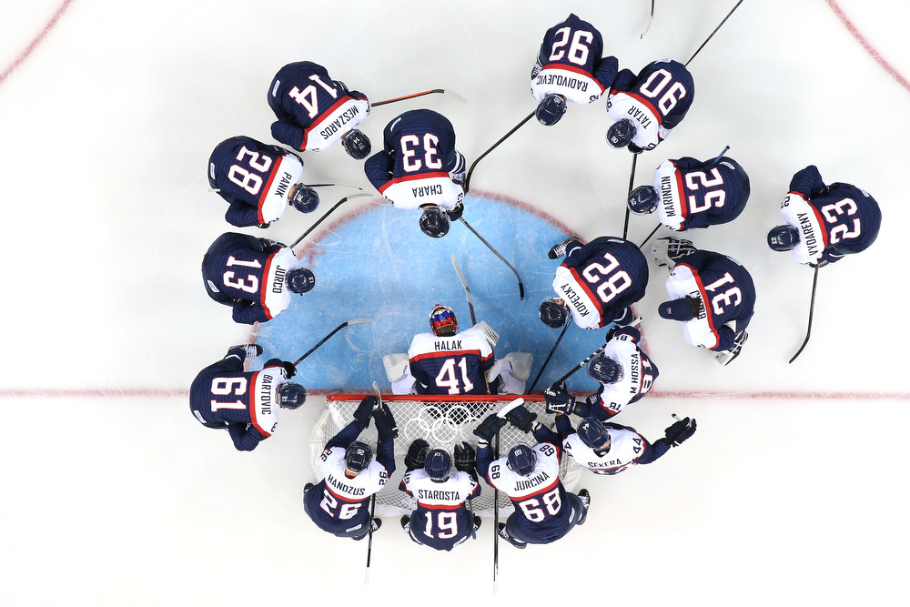 . Team USA gathers by the net prior to their Men\'s Ice Hockey Preliminary Round Group A game against Slovakia on day six of the Sochi 2014 Winter Olympics at Shayba Arena on February 13, 2014 in Sochi, Russia.  (Photo by Martin Rose/Getty Images)
