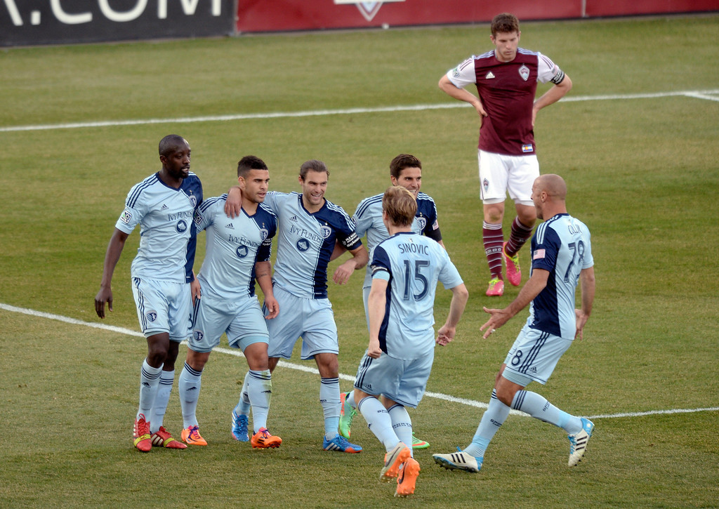 . Kansas City forward Dom Dwyer (14) celebrated his game winning goal with teammates. Sporting Kansas City defeated the Colorado Rapids 3-2 Saturday evening, March 29, 2014 at Dick\'s Sporting Goods Stadium in Commerce City.  (Photo by Karl Gehring/The Denver Post)