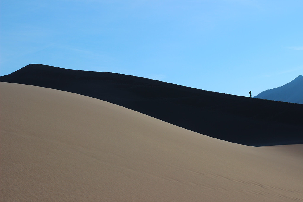 Great Sand Dunes National Park, Colorado.  <br /> I was prepared to press the shutter button when the hiker reached the point where the mountains touched the dune. At the last moment, he turned to reflect on how far he had come. It wouldn't have been the same photograph if he hadn't stopped right there.