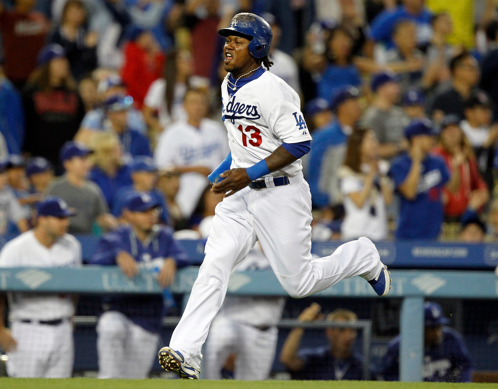 . Los Angeles Dodgers\' Hanley Ramirez scores on a single by Matt Kemp in the third inning of a baseball game against the Colorado Rockies on Monday, June 16, 2014, in Los Angeles.   (AP Photo/Alex Gallardo)