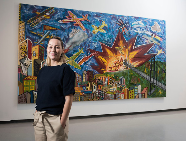 Curator of Contemporary & Indigenous art for the Winnipeg Art Gallery, Jaimie Isaac with Roger Craiti's Babble on Babylon, Babel on, (2003) during a sneak peak of Skate, Snow, Surf, Two Boarding Shows Celebrating Indigenous Art at the Winnipeg Art Gallery November 17, 2016  (David Lipnowski for Metro News)