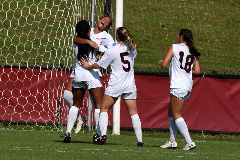 Davidson's Michele Manceaux celebrates with Cameron France after the duo teamed up to score against Dayton. France drew the goalie out of position and then passed the ball to Manceaux, who had a direct shot on goal. Wildcats Natalie Connell (5) and Seeley Yoo (18) rush to join the celebration.