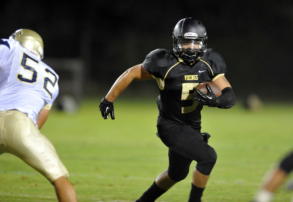 . Northview\'s Bryan Salinas (#5) runs around a Rowland defender in their non-league game at Covina District Field in Covina on Friday September 13, 2013.  (San Gabriel Valley Tribune/Staff Photo by Keith Durflinger)
