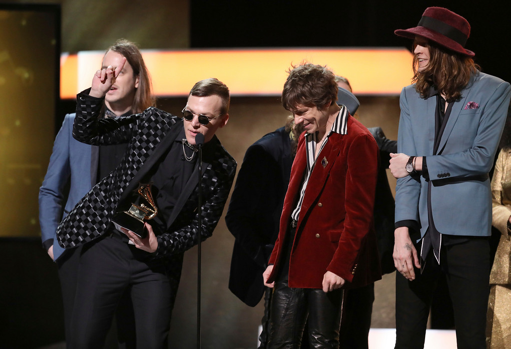 ". Brad Shultz, from left, Matt Shultz, and Daniel Tichenor of ""Cage the Elephant\"" accept the award for best rock album for \""Tell Me I\'m Pretty\"" at the 59th annual Grammy Awards on Sunday, Feb. 12, 2017, in Los Angeles. (Photo by Matt Sayles/Invision/AP)"