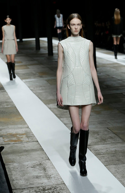 . Models walk the runway during the Theyskens Theory Fall 2013 runway show at Fashion Week in New York, Monday, Feb. 11, 2013.  (AP Photo/Kathy Willens)