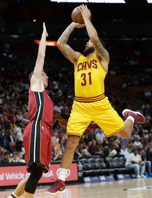. Cleveland Cavaliers\' Deron Williams (31) drives to the basket as Miami Heat\'s Goran Dragic defends during the first half of an NBA basketball game, Saturday, March 4, 2017, in Miami. (AP Photo/Lynne Sladky)